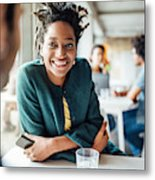 Smiling Businesswoman Sitting With Colleague In Cafeteria Metal Print