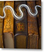 Snake And Antique Books Metal Print