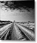snow covered untreated rural small road in Forget Saskatchewan Canada Metal Print