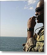 Soldier Instructs Small Boat Maneuvers Metal Print