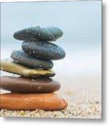 Stack Of Beach Stones On Sand Metal Print by Michal Bednarek
