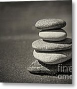 Stacked Pebbles On Beach Metal Print