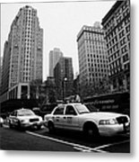 Steam Of Yellow Cabs With Headlights On Heading Down Broadway At Herald Square Outside Macys Nyc Usa Metal Print