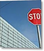 Stop Sign And Building In The Background Metal Print