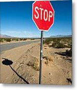Stop Sign On Indian Ranch Road In Death Valley Metal Print