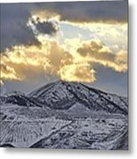 Stormy Sunset Over Snow Capped Mountains Metal Print