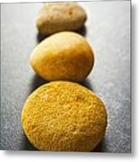 Straight Line Of Brown Pebbles On Dark Background Metal Print by Colin and Linda McKie