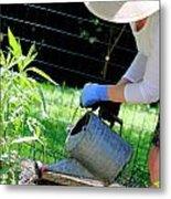 Straw Hat Gardener Metal Print