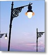 Street Lamps Over Sunset Sky Background Metal Print
