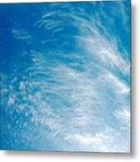 Strong Winds Forming Cirrus Clouds With A Deep Blue Sky. Metal Print