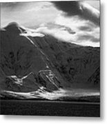 sunlight breaking through clouds on snow covered landscape of anvers island and neumayer channel Ant Metal Print