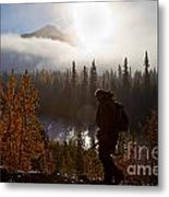 Sunrise Hiker Metal Print by Chris Heitstuman