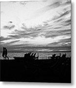 sunset over couple walking along the beach at playa de las americas Tenerife Canary Islands Spain Metal Print