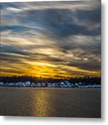 Sunset Over Snow Covered Village Metal Print