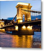 The Chain Bridge In Budapest Lit By The Street Lights Metal Print