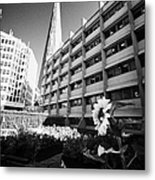 the shard building towering over melior street community garden London England UK Metal Print