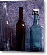 Three Old Empty Bottles On Painted Background Metal Print by IB Photo
