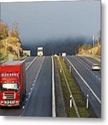 Trucks Driving Through A Misty Mountain Pass Metal Print