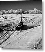two men on snowmobiles crossing frozen fields in rural Forget Saskatchewan Canada Metal Print
