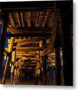Under The Pier At Night Metal Print