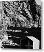 vertical small shrine with cross made out of sea shells on rocky coastline at punta de teno Tenerife Canary Islands Spain Metal Print