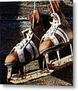 Vintage Pair Of Mens  Ice Skates Hanging On A Wooden Wall With C Metal Print