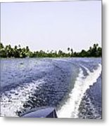 Wake From The Wash Of An Outboard Motor Boat In A Lagoon Metal Print