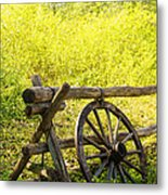 Wheel On Fence Metal Print