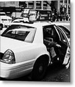 white caucasian passenger closes rear door of yellow cab on taxi rank at crosswalk on 7th Avenue Metal Print