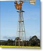 Windmill In A Canola Field Metal Print