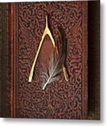 Wishbone And Feather On Antique Book Metal Print