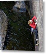 Woman Climbing Above A River Metal Print
