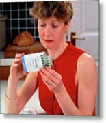 Woman Reading Dose Label On Pack Of Prozac Pills Metal Print