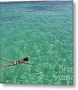 Woman Snorkeling By Turquoise Sea Metal Print