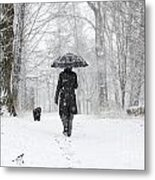 Woman Walking In A Snowy Forest Metal Print