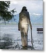 Woman With A Stick Metal Print