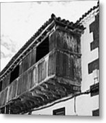 wooden balcony on ancient stucco covered traditional flat roofed house in tacoronte Tenerife Canary Islands Spain Metal Print