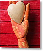 Wooden Hand With White Heart Metal Print