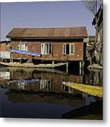 Yellow Shikara In Front Of A Run Down Area Of Houses In The Dal Lake Metal Print