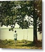 Young Boy Looking Out At The Water Under A Big Tree Metal Print