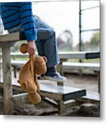 Young boy sitting by himself on on bleachers. Metal Print
