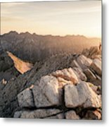 Young Man Scrambles To The Summit Metal Print