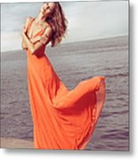 Young Woman In Orange Dress Flying In The Wind At Sea Shore Metal Print by Oleksiy Maksymenko