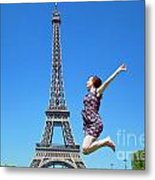 Young Woman Jumping Against Eiffel Tower Metal Print