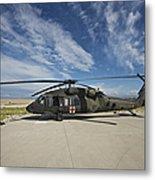 A Uh-60l Blackhawk Parked On Its Pad Metal Print