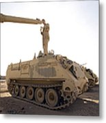 A Us Army Mechanic Uses A M113 Metal Print