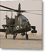 An Ah-64 Apache Helicopter Taxiing Metal Print