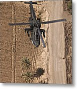 An Ah-64d Apache Helicopter In Flight Metal Print