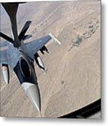 An F-16 Fighting Falcon Receives Fuel Metal Print by Stocktrek Images