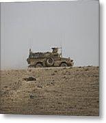 An Mrap Vehicle Patrols The Ridge Metal Print